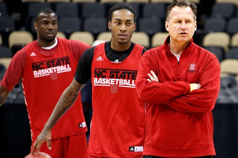 ASSOCIATED PRESS NC State coach Mark Gottfried watches practice as Desmond Lee (left) and Anthony Barber (center) wait their turns to run a drill in preparation for game against Villanova.