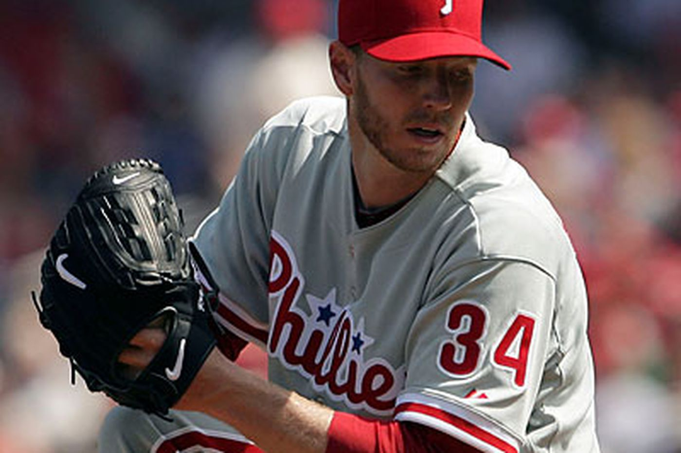 Halladay, big bats star in Phillies' opening win over Nationals