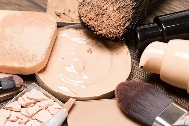 Basic makeup products for flawless complexion: foundation, concealer, powder, cosmetic sponge, brushes.