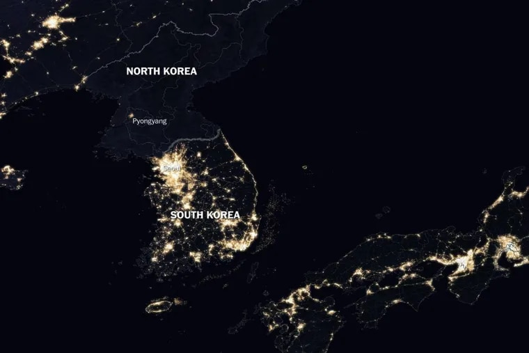 NASA view of the Korean Peninsula at night illustrates the relationship between nighttime lighting and economic activity: North Korea is almost entirely dark, while South Korea sparkles with light.