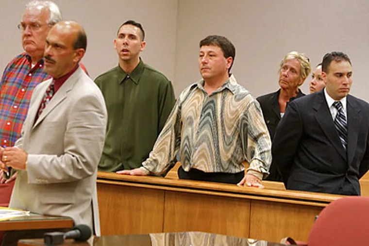 Jack Buscemi Jr. (center, wearing the patterned shirt) was described as the boss of a $60 million betting ring based at the Borgata hotel in Atlantic City. (David M Warren/Staff file photo)