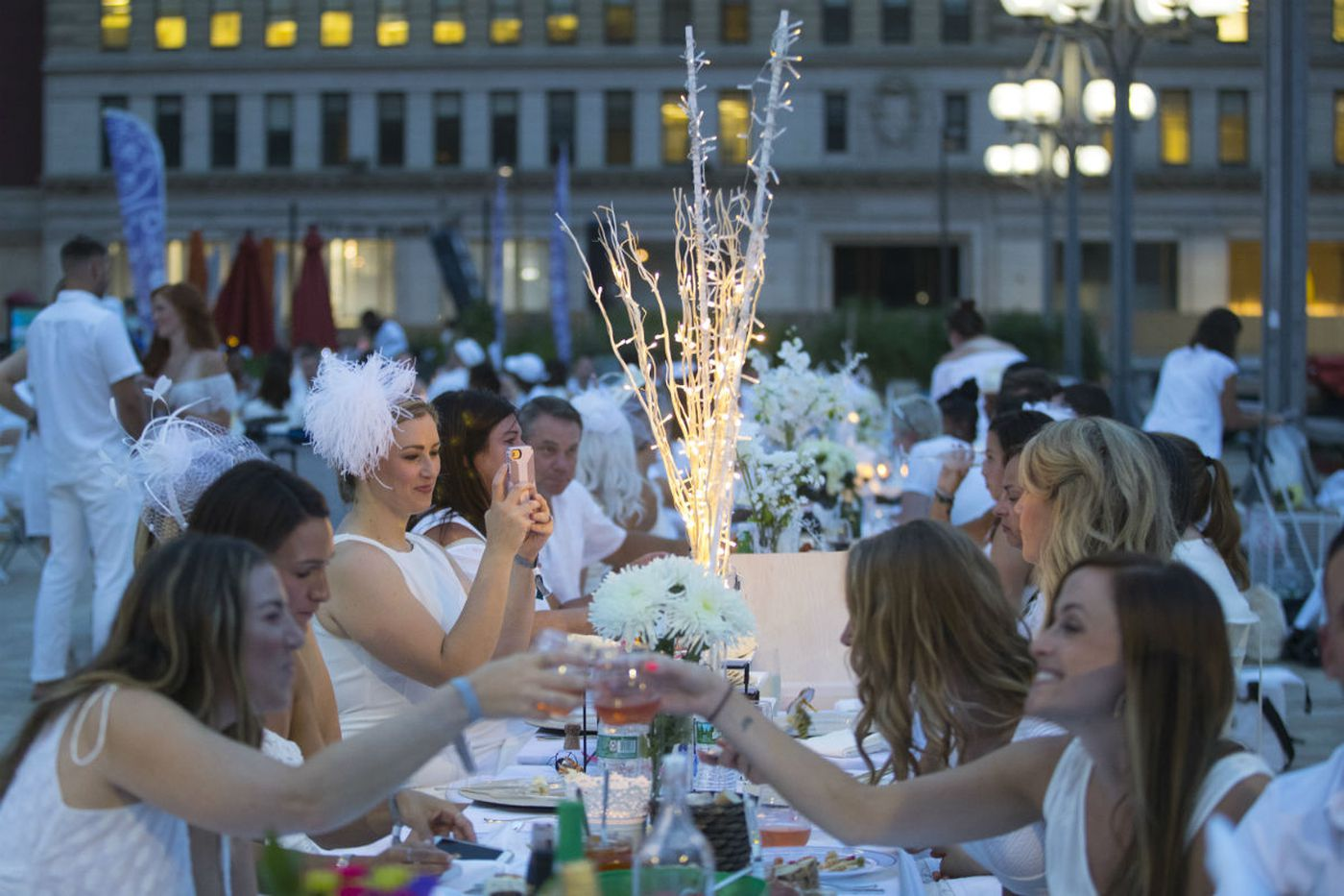 It's a party in white as Dîner en Blanc sets up outside City Hall
