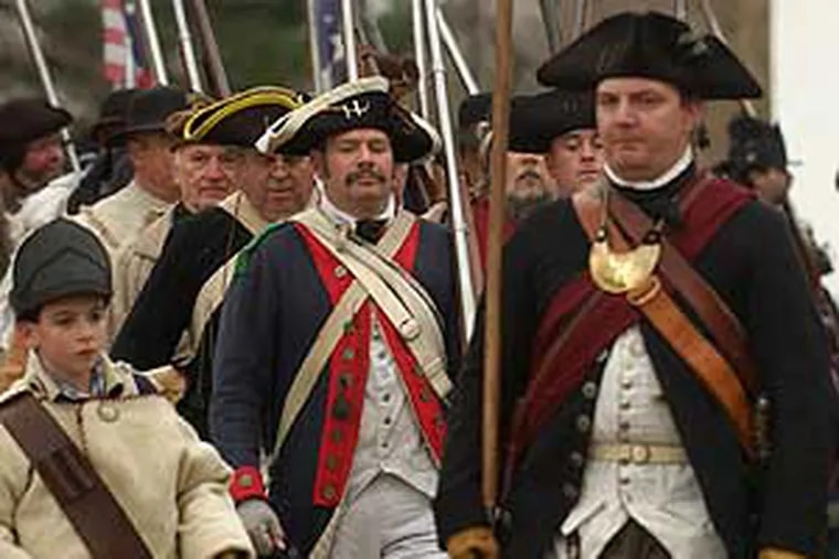 Last year's Gen. George Washington, played by Robert Gerenser, on the march into Washington Crossing Park