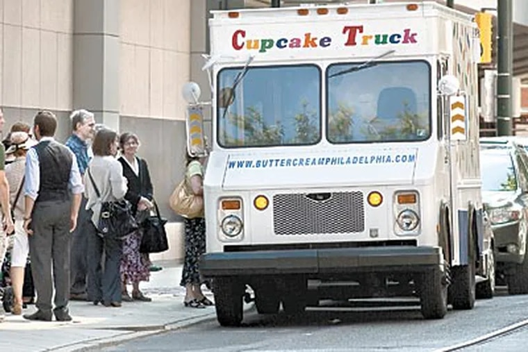 """Kate Carrara's cupcake truck in happier times. """"L&I confiscated the truck due to map disputes,"""" Carrara wrote Tuesday on Twitter, to the dismay of her legion of fans. (Ed Hille / Staff Photographer)"""