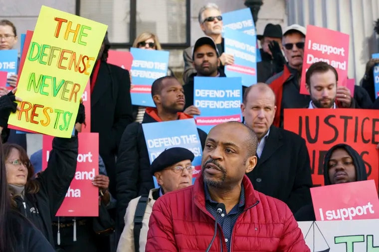 Reggie Shuford, executive director of the ACLU of Pennsylvania, speaks to protestors gathered on the steps of the Montgomery County Courthouse about the firings of public defenders Dean Beer and Keisha Hudson in Norristown, Pa., March 5, 2020.