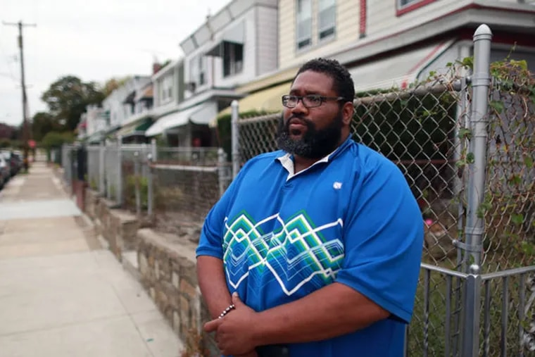 Eric Patterson works with the homeless and disabled. When he was 19 he served time for a conviction. He was pardoned by the governor and the case was expunged. But a court debt of $5,000 remained on his credit report and over his life for decades. Friday October 10, 2014. ( DAVID SWANSON / Staff Photographer )