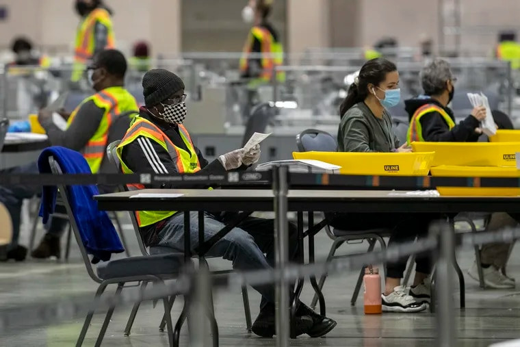 Mail ballots are counted at the Pennsylvania Convention Center on Nov. 4.