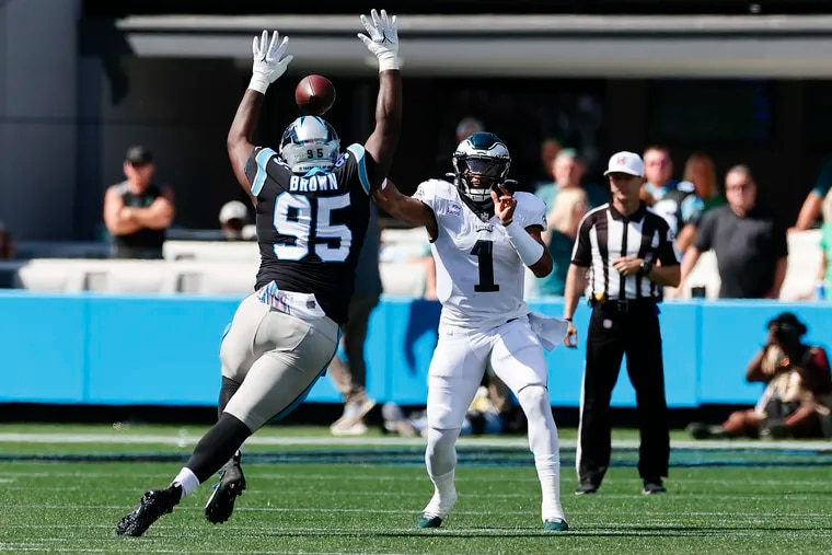 Eagles quarterback Jalen Hurts tries to throw the football over Carolina Panthers defensive tackle Derrick Brown during the first quarter on Sunday, October 10, 2021 in Charlotte.