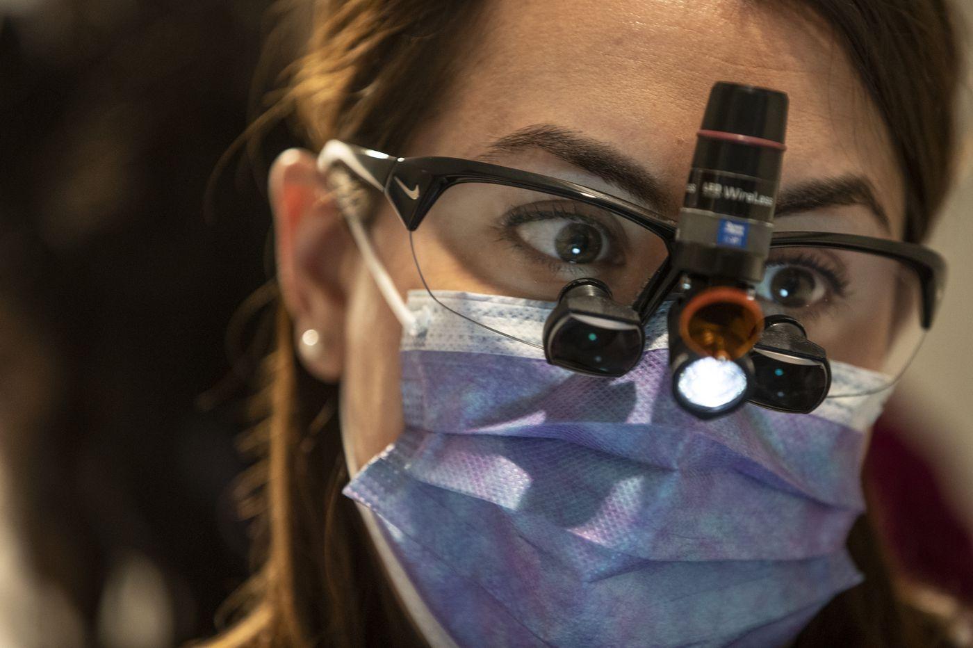 Under the Broad Street line, dentist Janine Burkhardt gets patients smiling again