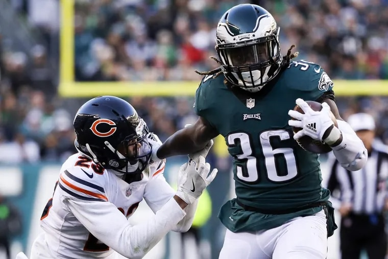Eagles running back Jay Ajayi runs with the football past Chicago Bears cornerback Kyle Fuller in the fourth quarter on Sunday.