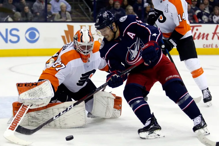 Right winger Cam Atkinson, then with Columbus, goes hard to the net against Flyers goalie Brian Elliott during a 2019 game. The Flyers acquired Atkinson by sending Jake Voracek to Columbus on Saturday