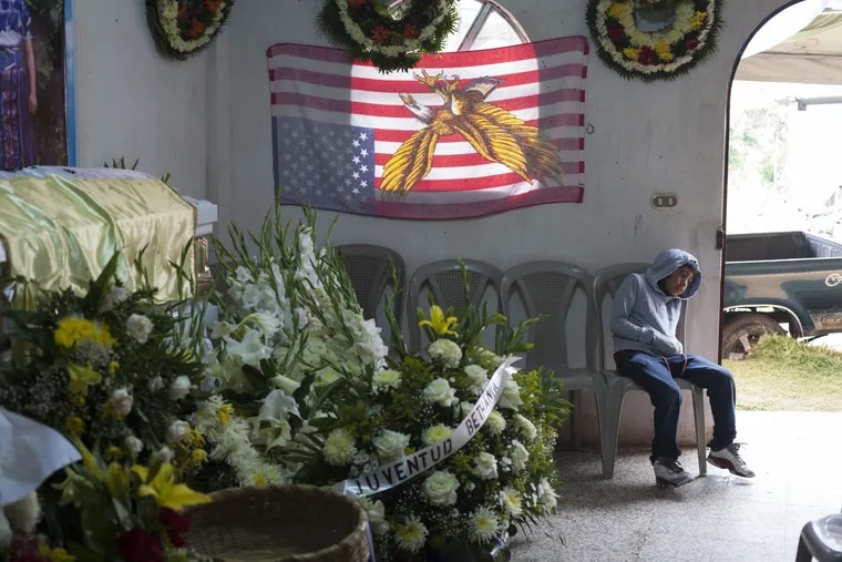 A boy attends the June 1 wake of slain Guatemalan immigrant Claudia Gomez Gonzalez at her parent's home in San Juan Ostuncalco, Guatemala. The 19-year-old, who was fatally shot by a U.S. Border Patrol agent in Texas on May 23, had graduated as a forensic accountant but was unable to attend college or find a job, so she had left Guatemala for the U.S., according to her aunt.