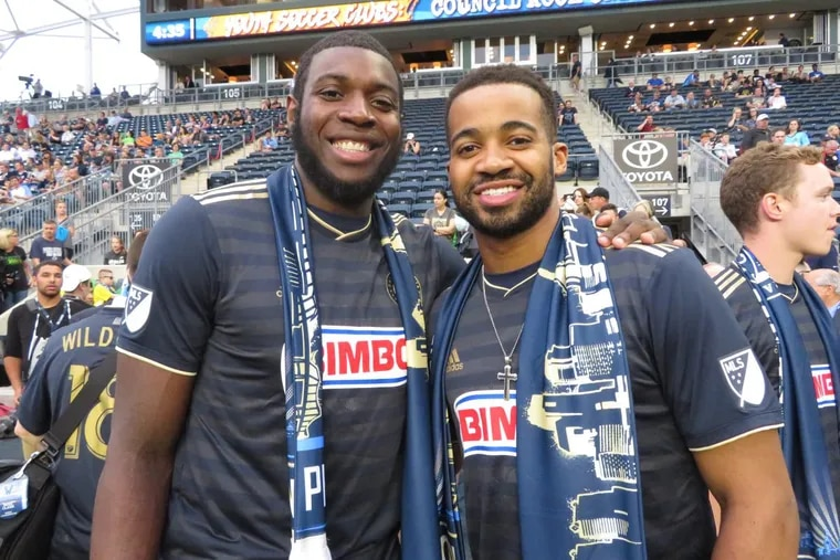 Eric Paschall (left) and Phil Booth were among the Villanova basketball players honored before the Union's game with Chicago.