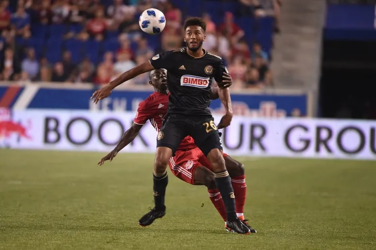 Philadelphia Union defender Auston Trusty watches the ball as he battles with New York Red Bulls striker Bradley Wright-Phillips during the teams' scoreless tie at Red Bull Arena.