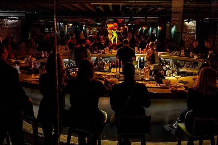 A view of the main bar at Fabrika, with performers on the round, hydraulic stage at rear.