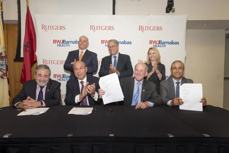 Signing a partnership agreement between Rutgers University and RWJBarnabas Health to form New Jersey's largest academic health care system are (first row l. to r.)Brian Strom, Chancellor, Rutgers Biomedical and Health Sciences,Barry H. Ostrowsky, President and CEO, RWJBarnabas Health, Robert Barchi, President, Rutgers University,Vicente H. Gracias, President and CEO, Rutgers Health Group (back row l. to r.) Jack Morris, Chair, RWJBarnabas Health Board of Trustees, Marc Berson, Vice Chair, RWJBarnabas Health Board of Trustees and Kathleen Bramwell, Senior Vice Chancellor, Administration and Finance, Rutgers Biomedical and Health Sciences