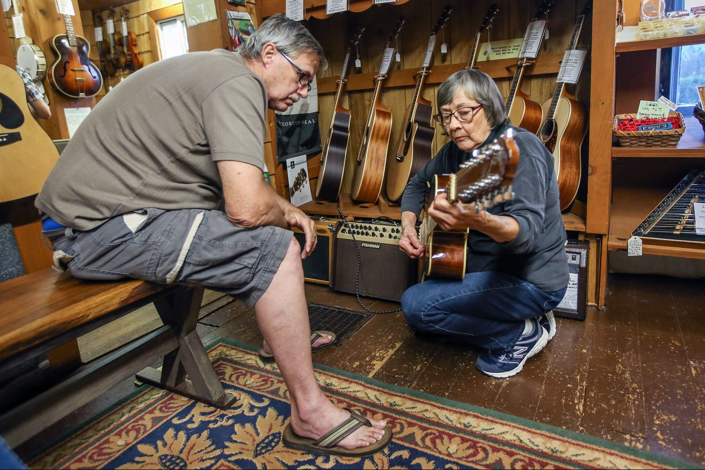 Decades after America's folk revival, specialty music stores keep afloat