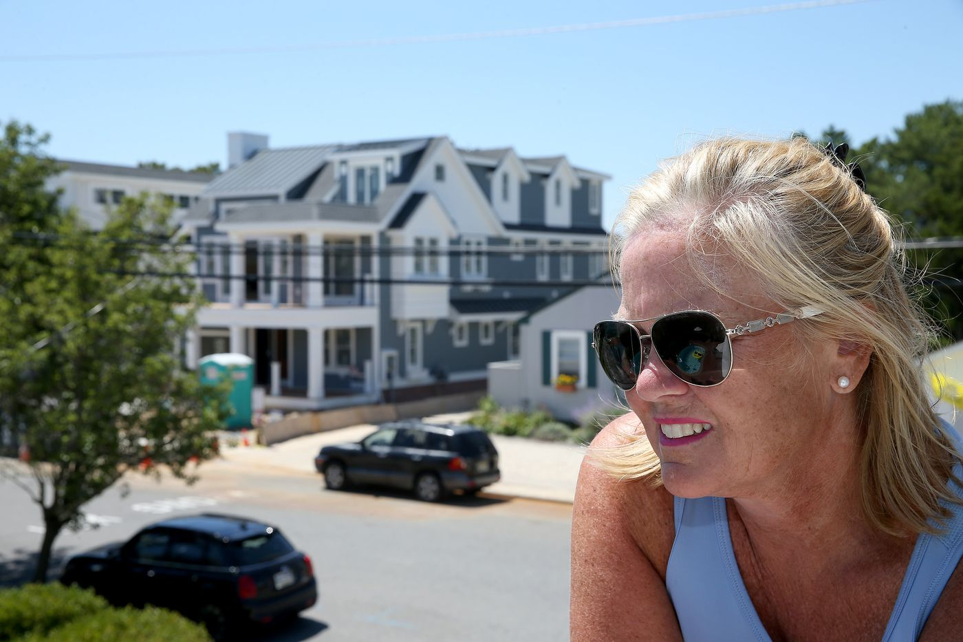 'I can't even take an outdoor shower.' In Avalon, 'sacred summer' is threatened by the contractors next door