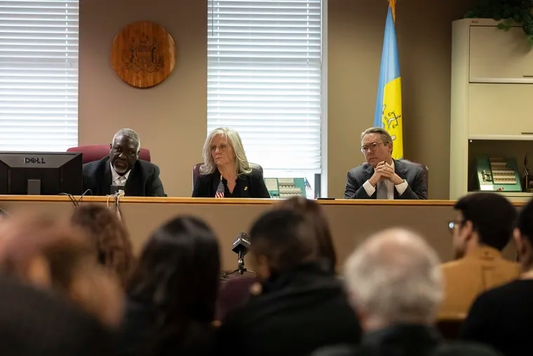 Philadelphia City Commissioners Anthony Clark, left, Lisa Deeley, and Al Schmidt listen during a meeting Feb. 20, 2019.