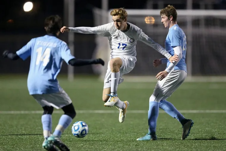 Princeton's Remy Hebert (14) and Andrew Beamer  defend against Washington Township's Ed Rainey (17) during their Group 4 state semifinal.