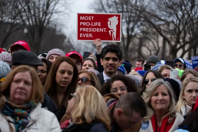 In this Jan. 24, 2020, file photo, supporters listen as President Donald Trump speaks during the annual March for Life rally on the National Mall in Washington. Anti-abortion leaders across America were elated a year ago when Trump became the first sitting U.S. president to appear in person at their highest-profile annual event, the March for Life, held every January. This year's March for Life will be virtual.