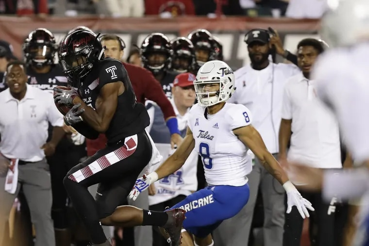 Temple cornerback Ty Mason intercepts the football in front of Tulsa wide receiver Keenen Johnson during the first-quarter on Thursday, September 20, 2018 in Philadelphia. Mason scored a 36-yard touchdown after the interception. YONG KIM / Staff Photographer