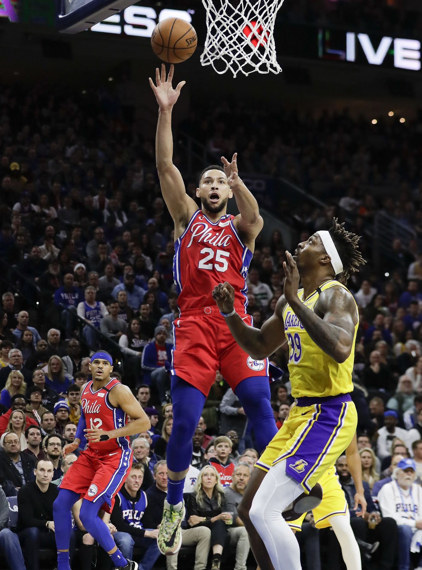 Sixers guard Ben Simmons lays-up the basketball past Los Angeles Lakers center Dwight Howard during the first-quarter on Saturday, January 25, 2020 in Philadelphia.