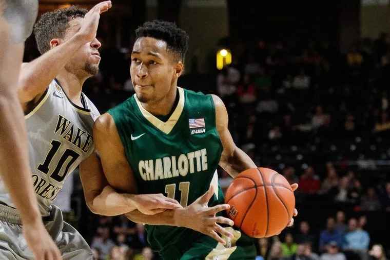 Quentin Jackson (11) of Charlotte driving on Mitchell Wilbekin of  Wake Forest in December 2016. Scott Kinser/Cal Sport Media