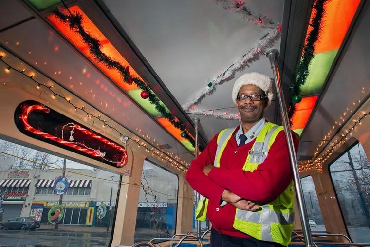 Gary Mason, veteran SEPTA trolley operator, decorates his car with festive lights each holiday season.