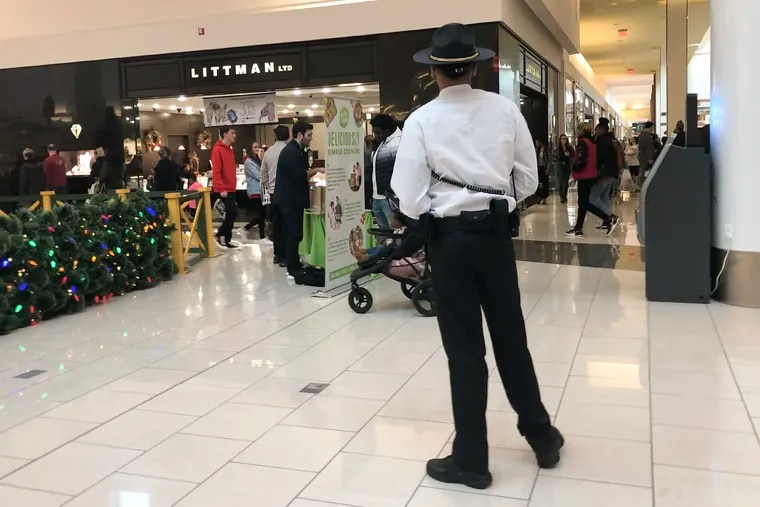A Cherry Hill Mall security member stands on patrol inside the mall on Thursday, December 26, 2019.  Teens in the past have been known to cause mayhem after Christmas and this year they have to be accompanied by an adult.