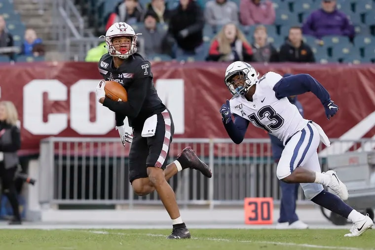 Temple's Branden Mack looks back at UConn's Messiah Turner and heads for the end zone after catching a long pass and taking it for a  touchdown on Nov. 30.