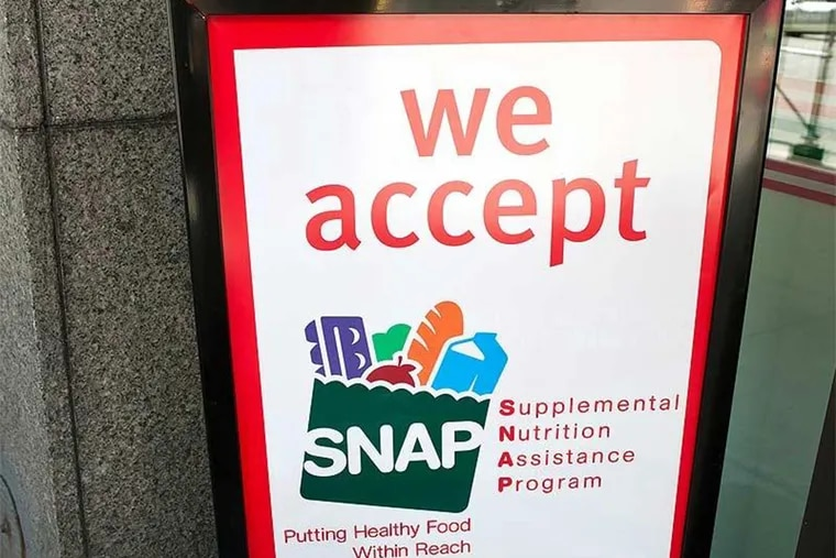 A sign indicates a store that accepts the Supplemental Nutrition Assistance Program or SNAP, the official name of the food stamp program.