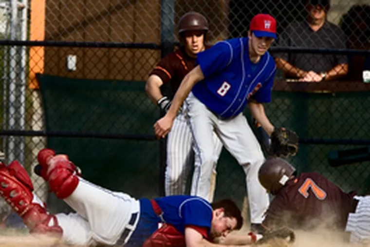 Mike Giuliano scores the winning run in the bottom of the sixth inning, beating the tag of Washington Township catcher T.J. Alcorn as the Minutemen's Nate Young (front) and the Chiefs' Chris Carlontonio looked on. The Chiefs managed just two hits but won, 2-1, behind the pitching of Alex Pracher.