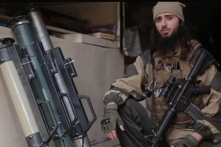 A screen grab from an ISIS video shows Zulfi Hoxha of Margate, N.J. issuing threats against the United States.