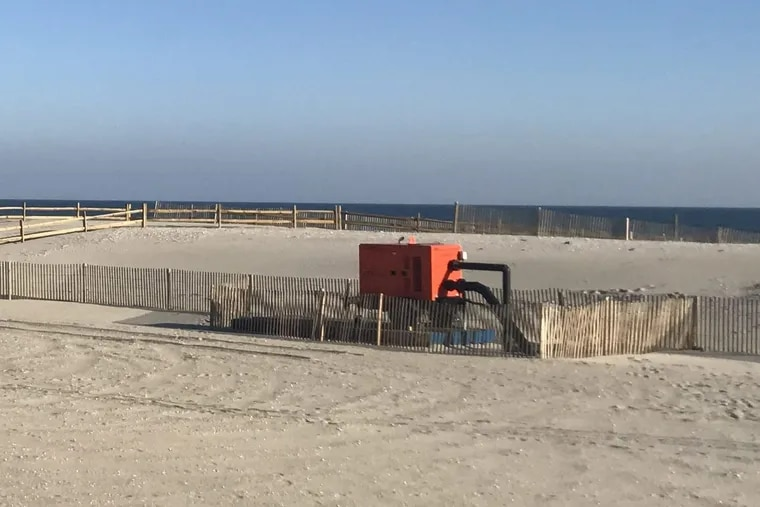 Orange pumps are temporary solutions to the drainage problem created by the dunes in Margate. They will remain on the beach until work is completed on a permanent drainage solution, which will take one year.