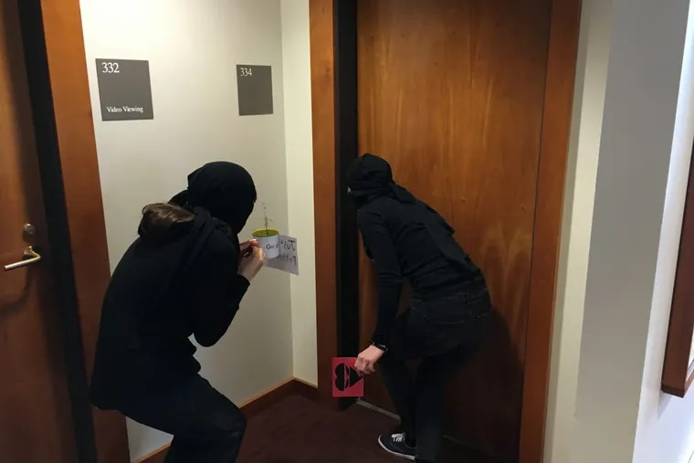 Ninja Valentine deliverers close in on a classroom at Swarthmore College.