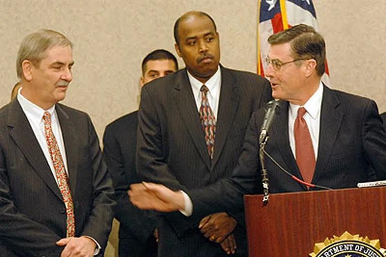 Officials announce arrests in a meth distribution network. Camden County Prosecutor Warren W. Faulk, right, U.S. Attorney James Lynch, left, and U.S. Postal Inspector Oriey Glenn, center. (April Saul / Staff Photographer)