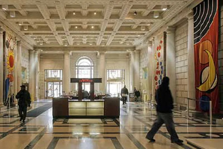 Four banners that Alexander Calder designed in 1975 for the atrium of the then-new Centre Square towers are displayed in the lobby the Free Library. (Akira Suwa / Staff Photographer)