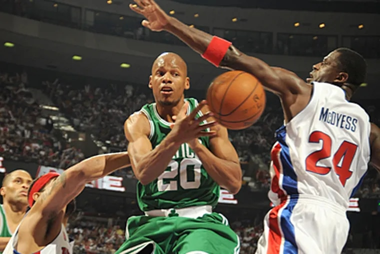 Ray Allen of the Boston Celtics throws a pass past Antonio McDyess of the Detroit Pistons in Game Four of the Eastern Conference Finals on Monday. The Pistons pulled even in the series. (Allen Epstein.NBAE via Getty)