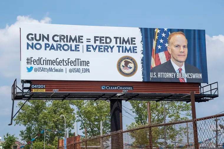 A billboard seen from I-76 along New Hope Street in Philadelphia's Southbrook Park neighborhood, next to a used car lot. U.S. Attorney Bill McSwain is using Department of Justice funds to run an ad campaign about his office's prosecution of gun crimes.