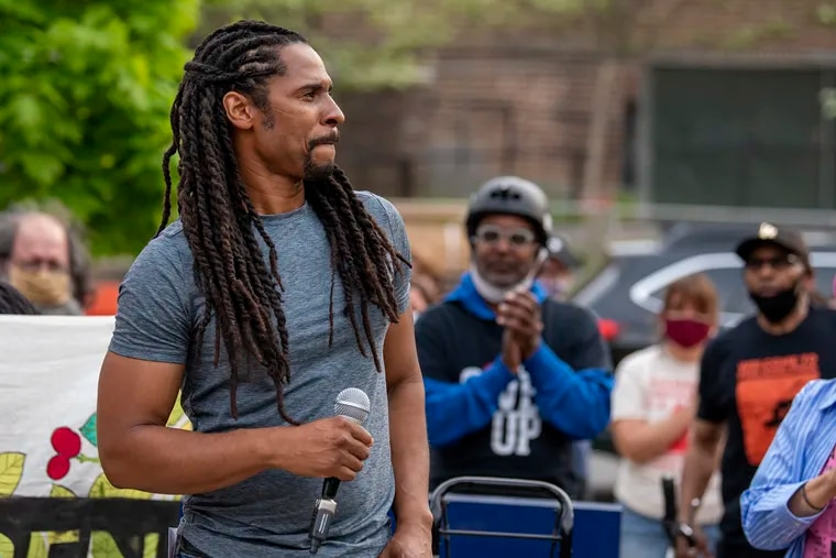 Family member Mike Africa, Jr. speaks during a protest April 28, 2021 in front of the Penn Museum over its handling of human remains from the MOVE bombing.