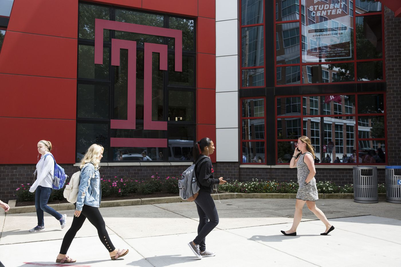 Students walk through the Temple University campus on the first day of the fall semester; classes will be offered online the rest of this semester.