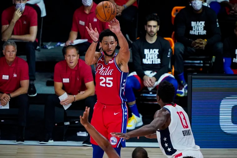 Philadelphia 76ers guard Ben Simmons (25) shoots over Washington Wizards center Thomas Bryant (13) during the second half of the game.