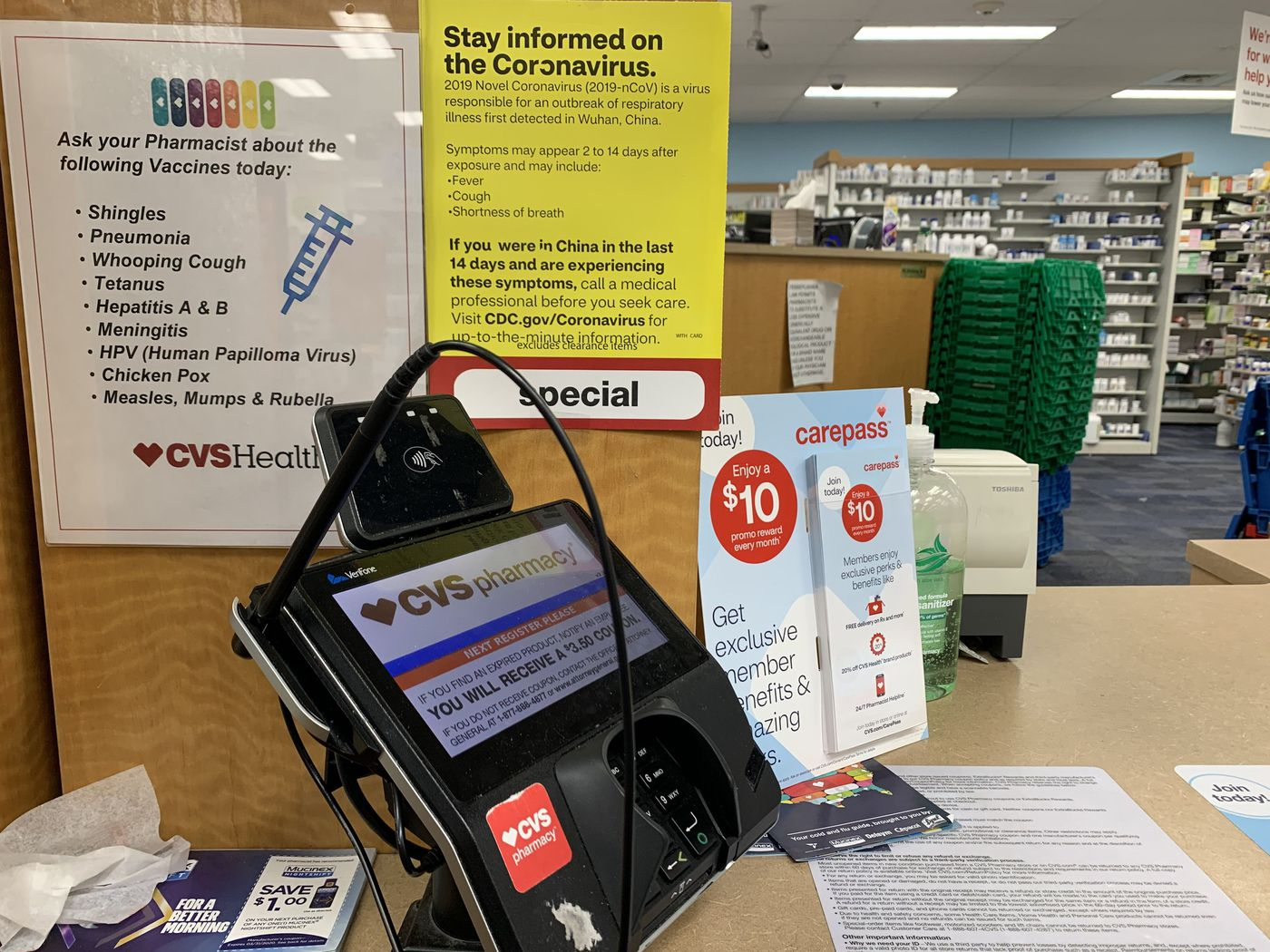 A sign with coronavirus information at the prescription counter of a CVS in Montgomery County, Pa., in suburban Philadelphia, Feb. 29, 2020.