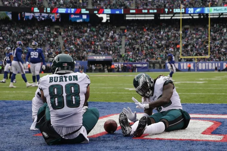 The Eagles are sitting pretty heading into Week 16 as Jay Ajayi, right, joins Trey Burton for a campfire/touchdown  celebration during Sunday's win over the Giants. DAVID MAIALETTI / Staff Photographer