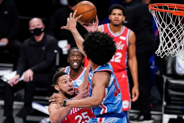 Brooklyn Nets' Jarrett Allen (31) blocks a shot by Philadelphia 76ers' Ben Simmons (25) during the first half of an NBA basketball game Thursday, Jan. 7, 2021, in New York. (AP Photo/Frank Franklin II)