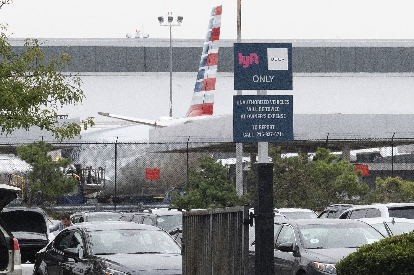 At Philly airport, Uber and Lyft drivers wait and wait
