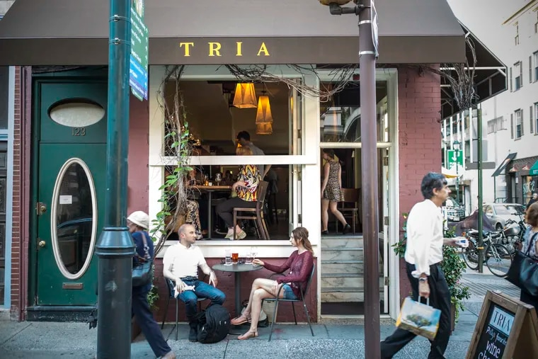 Pre-pandemic, guests sit in front of Tria Rittenhouse.