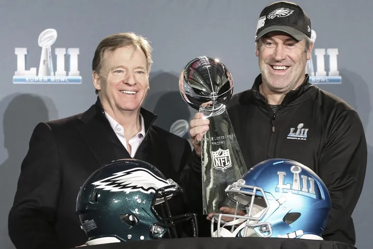 Eagles head coach Doug Pederson poses with the Lombardi Trophy and NFL Commissioner Roger Goodell the morning after winning Super Bowl LII in Minneapolis.