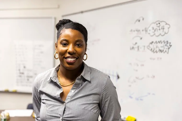 """Satoia Wright, 33, of West Philadelphia, Math teacher at Friends Select School, poses for a portrait in her classroom where students are taking an Algebra summer course in Spanish on Thursday, July 29, 2021. """"I think it's essential and I'm happy about the bilingual class,"""" Wright said. """"The students have the exposure and earlier access to algebraic concepts."""""""